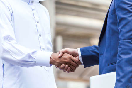 Successful businessmen handshake partner with arab businessman