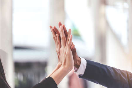 Successful hand of business team giving a high fives gesture 版權商用圖片