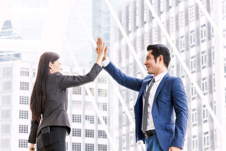 Successful  of business team giving a high fives gesture