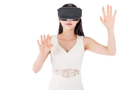 Young woman enjoy with virtual reality glasses isolated on white background
