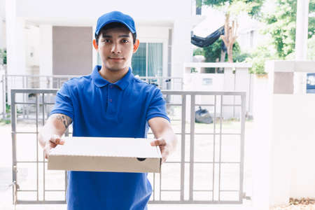 Delivery man holding boxes with pizza