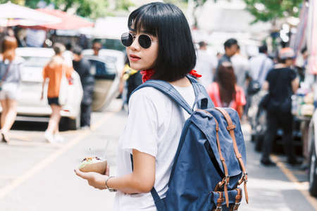 Asian woman tourist travel walk on the street Banque d'images