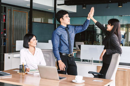 Successful business team giving a high fives gesture at office 版權商用圖片