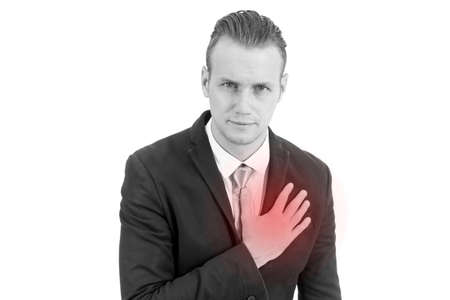 Businessman having heart attack or chest pain isolated on white background