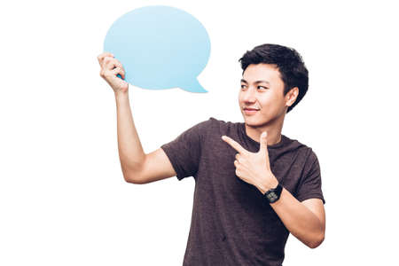 Young man holding up a speech bubble icon with copyspace