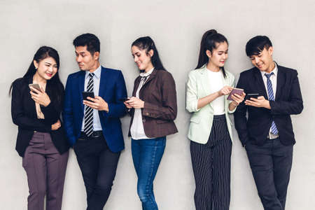 Group of business relax use technology together of smartphone  checking social apps and working.Communication concept