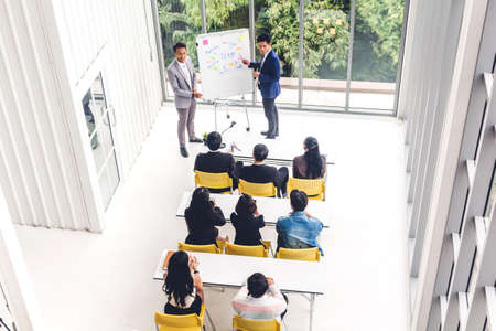 Group of casual business meeting and discussing with laptop computer.creative business people presenting and planning in modern workloft.Teamwork concept 版權商用圖片