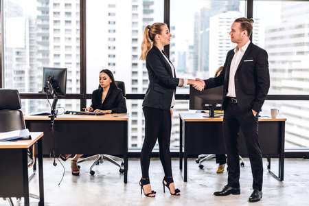 Success of handshake business partners.businessman and businesswoman making handshaking.Partnership approval and thanks gesture concept Standard-Bild