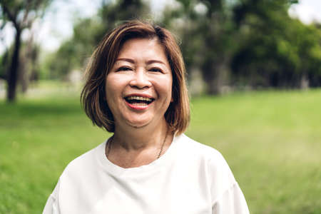 Portrait of happy senior adult elderly asia women smiling and looking at camera in the park.Retirement concept