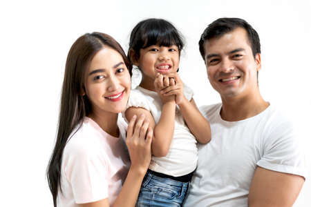 Portrait of happy family father and mother with daughter on white background