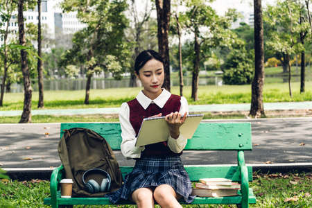 Students young woman relax and reading a book in park Stok Fotoğraf