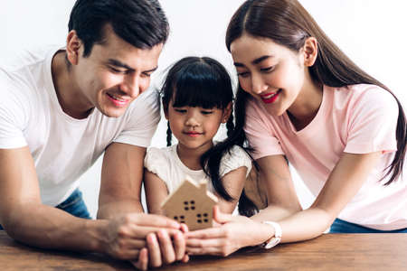 Happy family holding  house in hands.real estate concept