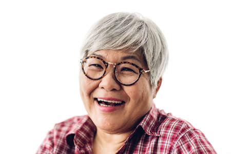 Portrait of happy senior adult elderly asia women smiling and looking at camera on white background.Retirement concept
