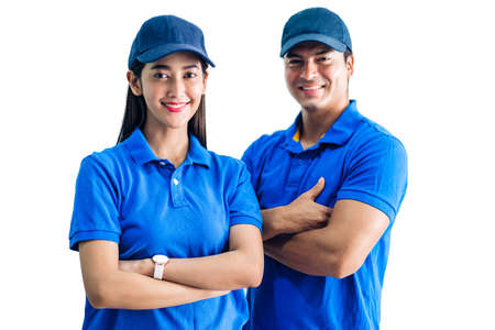 Portrait of smiling deliveryman and woman with crossed arms in blue uniform isolated on white background Standard-Bild