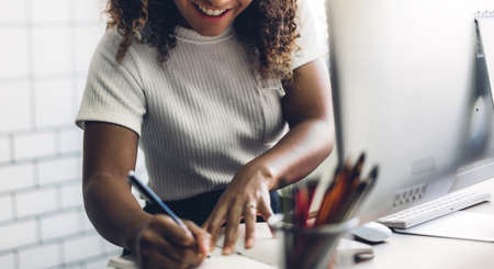African american black woman working with laptop computer.creative business people planning and using pen in modern work loft