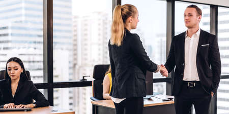 Success of handshake business partners.businessman and businesswoman making handshaking.Partnership approval and thanks gesture concept Stok Fotoğraf