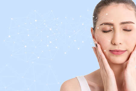 Beautiful woman beauty health care.beauty and spa with face tracking technology and science concept.perfect fresh skin isolated on blue background