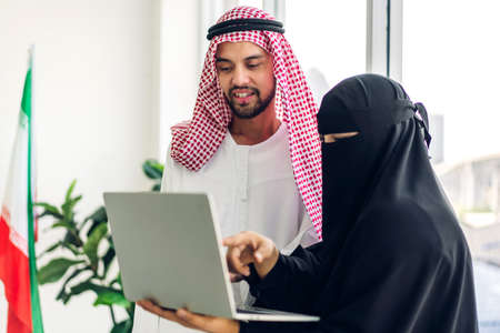 Two arabic business people working with laptop computer.creative arab business people planning at modern work loft