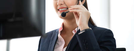 Beautiful businesswoman customer support services working with headset and computer at call center Stok Fotoğraf