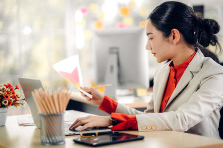 Businesswoman working with laptop computer.creative business people planning at modern work loft Reklamní fotografie