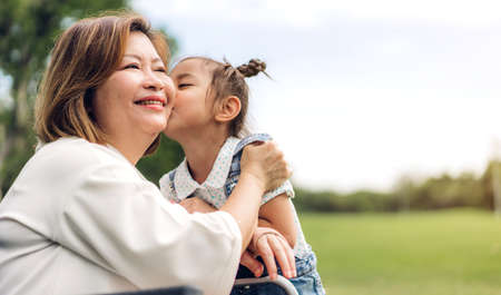 Portrait of happy grandmother and little cute girl enjoy relax together in summer park.Family and togetherness 版權商用圖片 - 161948252