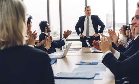 Group of professional business meeting and discussing management strategy with new startup project.Creative group of casual business people clapping hands in modern workloft.Teamwork concept