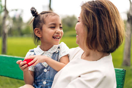 Portrait of happy grandmother and little cute girl enjoy relax together in summer park.Family and togetherness 版權商用圖片 - 162325664