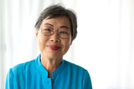 Portrait of happy senior adult elderly asia women smiling and looking at camera at home.Retirement concept Foto de archivo