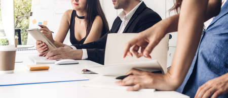 Group of professional business meeting and discussing strategy with new startup project.Creative business people planning and brainstorm with document report in modern workloft.Teamwork concept