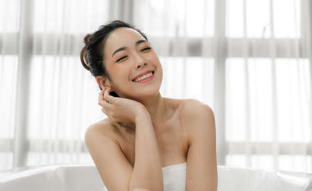 Beautiful woman perfect smile beauty health care.beauty and spa.perfect fresh clean healthy skin in room at home Foto de archivo