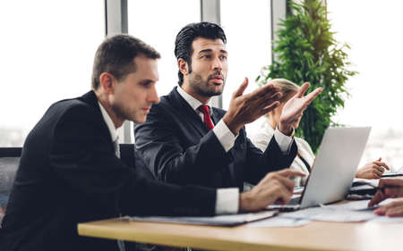Group of professional business meeting and discussing strategy with new startup project on laptop computer.Creative business people management planning and brainstorm with document report in modern workloft.Teamwork concept