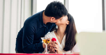 Beautiful couple in love and enjoying together eating meal sitting in the Restaurant 版權商用圖片