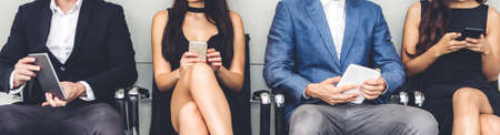 Group of business people sitting relax use technology together of smartphone checking social apps and work.Communication concept
