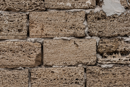 coquina: Background. The texture of the stone wall. Coquina material fastened with cement mortar.