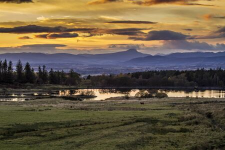 Golden sunset  over the Scottish Highlands photo