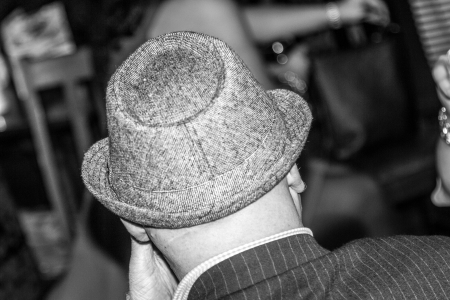 pin stripe: Man waring a gangster hat and pin stripe suit