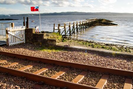 scottish flag: Scottish Flag blowing on Culross Pier, Fife Stock Photo