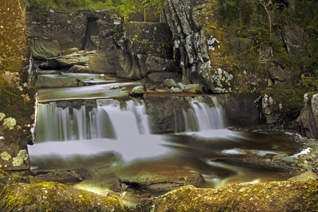 Beautiful and mysterious waterfall in Callander Scotland photo