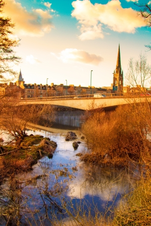 Beautiful colourful shot of a sunset on a bridge in Perth Scotland photo