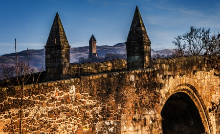wallace: Stirling Bridge and Wallace Monument below a blue sky