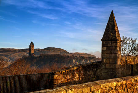 wallace: Close shot of Stirling Bridge with Wallace Monument in the background