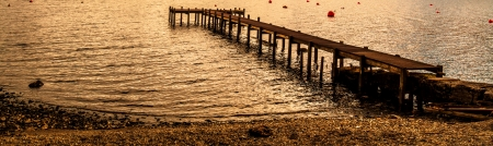 woody bay: A shot of a Pier at Lochernhead in Scotland