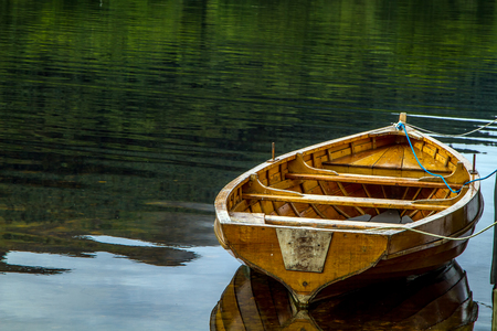 scotish: A Row Boat alone on Scotish Loch at Dawn Stock Photo