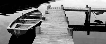 A Black and White shot of Row Boat photo