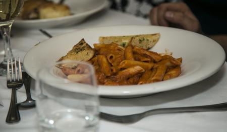 Pasta and garlic bread photo