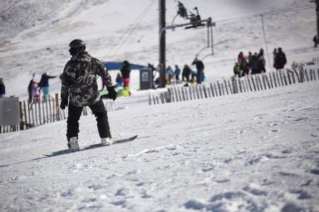 downhill: Downhill snowboarder