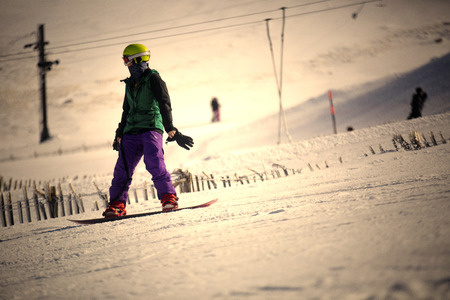 snowboarder: A shot of a snowboarder
