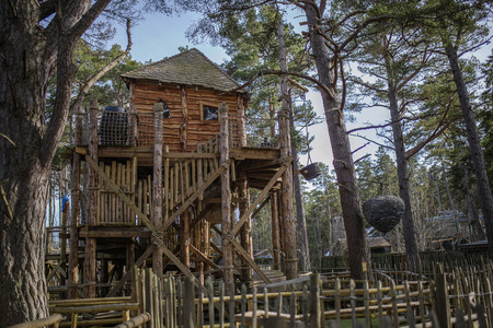 A cool treehouse in a forrest Stock Photo
