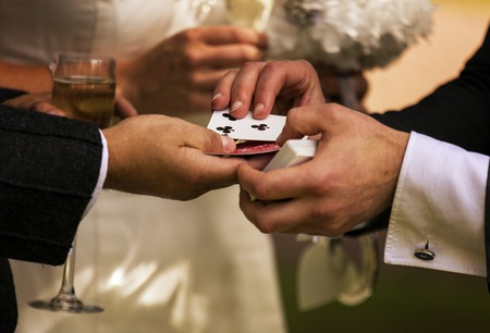 Shot of a magician performing a card trick