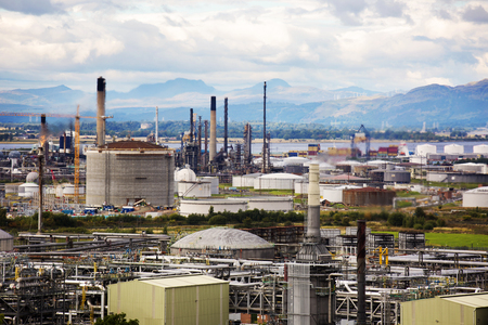 Close shot of an oil refinery on a cloudy day